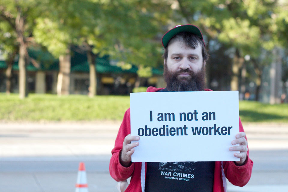Random guy holding a sign I made for Occupy.